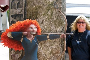 Our friend Kristi poses with Merida from Brave